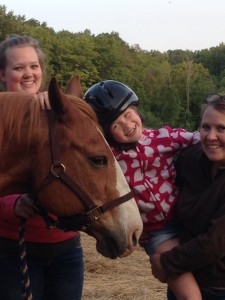 Our granddaughter Jaycee rides Rusty! Aunt Kathy and Kaley instucted and encouraged!
